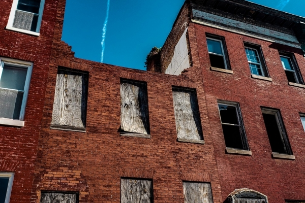 Abandoned brick buildings with boarded windows