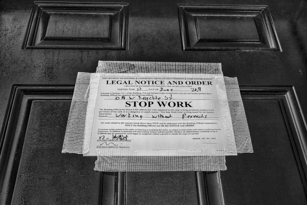 Stop work notice affixed to door