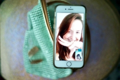 Portrait depicting Katie on iPhone