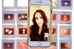 Portrait depicting Ari on iPhone