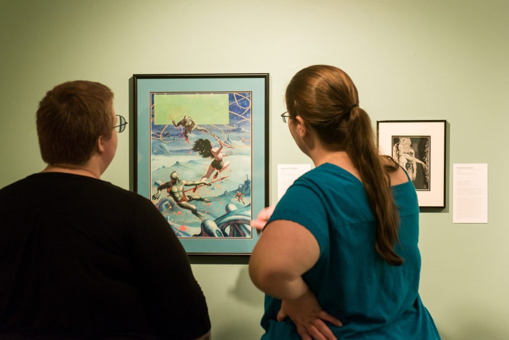Viewers Looking at Painting