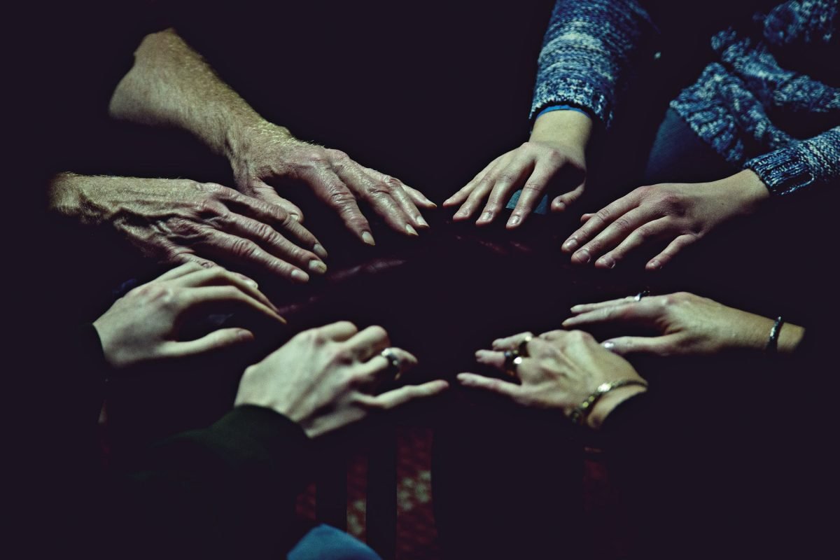 Outstretched hands forming circle